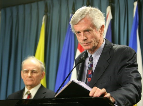 Former Canadian Secretary of State for Asia-Pacific David Kilgour (R) presents a revised report about the continued murder of Falun Gong practitioners in China for their organs. Report co-author and lawyer David Matas listens in the background, Jan. 31, 2007. (Matt Hildebrand/The Epoch Times)